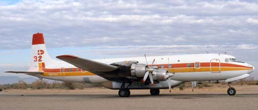 Douglas DC-7C, N9374Z Tanker 32 at the Gila Bend Indian Reservation Memorial Airport on December 30, 1981