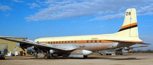 Douglas DC-7C, N90804 Tanker 28 at the Gila Bend Indian Reservation Memorial Airport on December 30, 1981