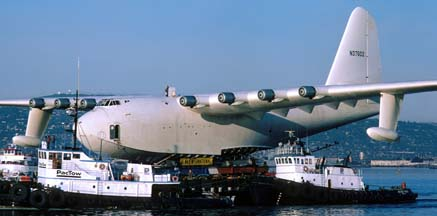 Howard Hughes' Flying Boat is barged to its new hangar