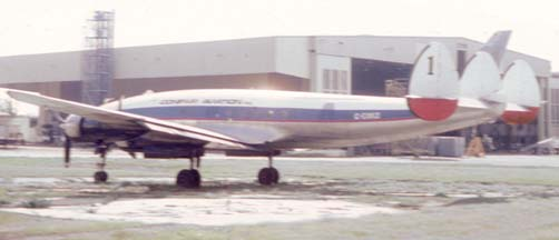 C-121A, 48-0609 in the colors of Conifair and registered C-GXKO at the Santa Barbara Airport in August 1984
