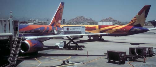 America West 757-2S7, N901AW Arizona taxis past N907WA Phoenix Suns at Phoenix Sky Harbor on July 6, 1997