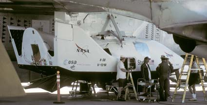 X-38 V-131R under the wing of Boeing NB-52B Stratofortress, 52-0008 on the flightline at Edwards AFB