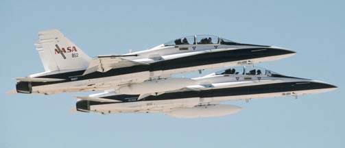 NASA Boeing-McDonnell-Douglas F/A-18B Hornets, N852NA and N846NA take off from runway 22 at Edwards AFB