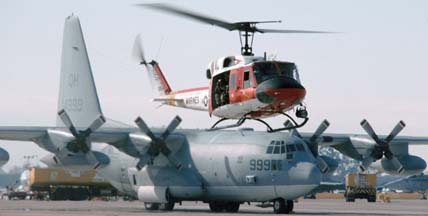 Base search and rescue Bell HH-1N Huey, 158554 and Lockheed KC-130T Hercules, 164999 of VMGR-234