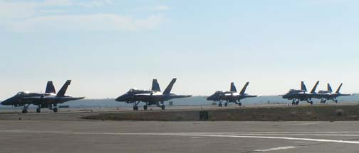 McDonnell-Douglas F/A-18 Hornets of the Blue Angels taxi to show center.