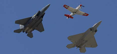 Air Force Heritage Flight: North American P-51D Mustang, N151AF Val Halla, McDonnell-Douglas F-15E-47 Strike Eagle, 89-0485, and Lockheed-Martin F-22A Raptor, 05-4086