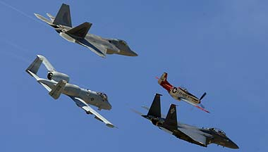 Air Force Heritage Flight: North American P-51D Mustang N151AF <em>Val Halla</em>, McDonnell-Douglas F-15E-47 Strike Eagle 89-0485 of the 4th Fighter Wing, Lockheed-Martin F-22A Raptor 05-4086 of the 1st Fighter Wing, and Fairchild-Republic A-10A Warthog 80-0206 of the 355th Wing