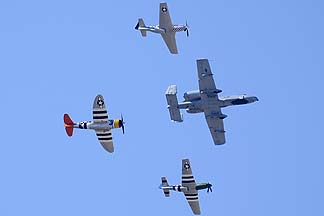 Republic P-47D Thunderbolt N4747P Tarheel Hal, North American P-51D Mustangs N4151D Galveston Gal and N20TF Bum Steer, and Fairchild-Republic A-10C Warthog 80-0278 of the 355th Fighter Wing, Davis-Monthan Air Force Base, March 4, 2012