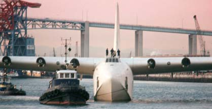 Howard Hughes' Flying Boat floats in Los Angeles Harbor at sunset
